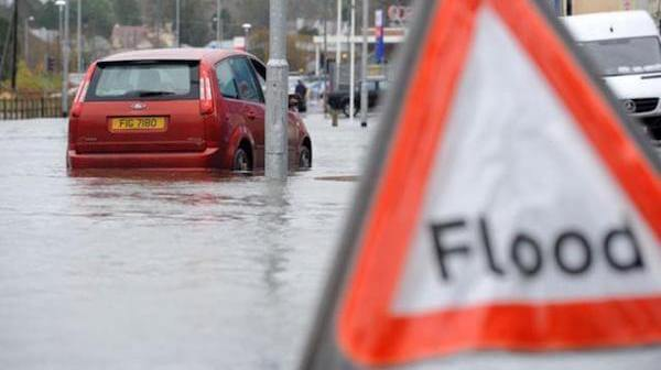 Flood sign & car